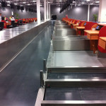 Check-in conveyors